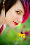 Punk woman in the garden Royalty Free Stock Images