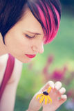 Punk woman plucking petals Royalty Free Stock Photography
