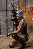 Punk woman with rifle Royalty Free Stock Photos