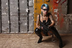 Punk woman with rifle Royalty Free Stock Photography