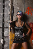 Punk woman with rifle Stock Photography