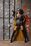 Punk woman with rifle Royalty Free Stock Images