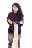 Punk young girl with pice of wood Stock Image