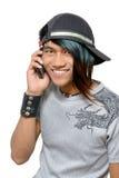 Punker asiático que llama por el teléfono celular Foto de archivo libre de regalías