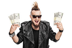 Punker die een paar stapels van geld houden Stock Afbeelding