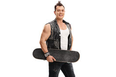 Punker holding a skateboard. Isolated on white background Stock Photography