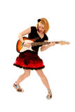 Punkmädchen, das Gitarre spielt Stockfotografie
