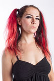 Punkmädchen mit dem roten Haar Stockfotos