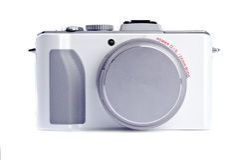 Punkt-und Eintragfaden-Digitalkamera getrennt auf Weiß Lizenzfreies Stockfoto