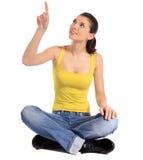 Punkte der jungen Frau zur Oberseite Stockfotos