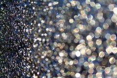 Punkte der Leuchte und der Sprünge auf dem Glas Lizenzfreies Stockfoto