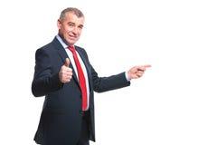 Punkter för affärsmannen som sid och, godkänner arkivfoto