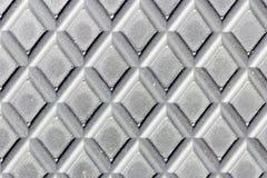 Punktierte Metallplatte. Glänzender Stahl. Lizenzfreies Stockfoto