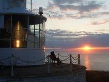 PunktLynas fyr på solnedgången Arkivbild