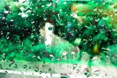 Punktvatten på exponeringsglas, vattenbackgroung Arkivbilder