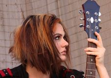 Punky girl with guitar Royalty Free Stock Photography