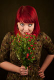 Punky Girl with Red Hair and Flowers Royalty Free Stock Photos