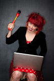 Punky Girl with Red Hair with Laptop Computer Royalty Free Stock Photo