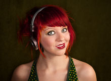 Punky Girl with Red Hair Listening to Music Royalty Free Stock Photo