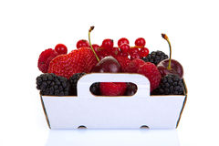 Punnet of fresh red summer fruits. Blackberries, cherries, strawberries, red currants and raspberries Stock Images