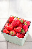 Punnet of fresh strawberries shot on summer day Royalty Free Stock Photos