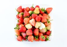 A punnet of strawberries on white background royalty free stock images