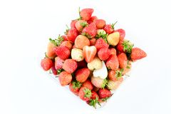 A punnet of strawberries on white background stock image
