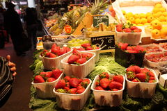 Punnets of strawberries and forest fruits Royalty Free Stock Images