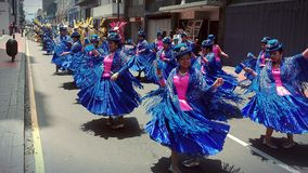Puno dancers caporales. Women dancing caporales from Puno at a parade in Lima, Peru Royalty Free Stock Photo