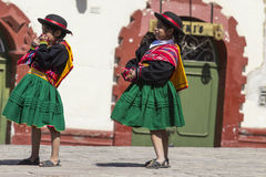 Puno, Peru - August 20, 2016: Native people from peruvian city d. Ressed in colorful clothing perform traditional dance in a religious celebration. Peru, South royalty free stock photos