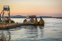 Puno, Peru - July 30, 2017: Boats of the traditional Uros village in Puno, Peru. Puno, Peru - July 30, 2017: The Boats of the traditional Uros village in Puno stock photos