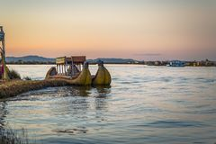 Puno, Peru - July 30, 2017: Boats of the traditional Uros village in Puno, Peru. Puno, Peru - July 30, 2017: The Boats of the traditional Uros village in Puno stock image