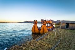 Puno, Peru - July 30, 2017: Boats of the traditional Uros village in Puno, Peru. Puno, Peru - July 30, 2017: The Boats of the traditional Uros village in Puno royalty free stock photo