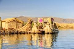 Lake Titicaca, Peru. PUNO, PERU - NOV 7, 2010: Floating island (Isla Flotante), Titicaca lake. Major touristic attraction in Peru stock photography