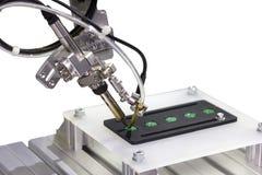 Punt die van het automatiserings het robotachtige systeem of voor PCB solderen lassen van de de kringsraad van de assemblagedruk  stock afbeeldingen