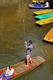 Punt on the river, Oxford. Man push a punt along with a long pole on river Cherwell, Oxford, Oxfordshire, England, UK, Western Europe Royalty Free Stock Image