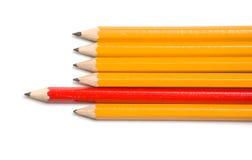 Punta amarilla y roja de los lápices dejada Imágenes de archivo libres de regalías