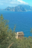 Punta Campanella and landscape of Sorrento`s peninsula and island of Capri. Tower on the path to Punta Campanella and landscape of sorrento`s peninsula and gulf Stock Images