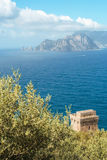 Punta Campanella and landscape of Sorrento`s peninsula and island of Capri. Tower on the path to Punta Campanella and landscape of sorrento`s peninsula and gulf Stock Photo