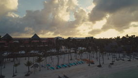Punta Cana, Dominican Republic aerial video over beachfront hotels. Punta Cana beachfront hotels and palm trees, aerial video stock video