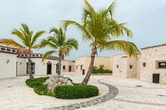 PUNTA CANA, DOMINICAN REPUBLIC - JUNE 18, 2015: Domincan Republic Architecture With Palm Tree. Stock Photos