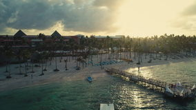 Punta Cana, Dominican Republic at sunrise. Aerial view over beachfront hotels and palm trees. Punta Cana beachfront hotels and palm trees, aerial video stock video
