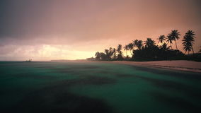 Punta Cana, Dominican Republic at sunset. Rain on the beach. Video stock video footage