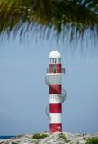 Punta Cancun lighthouse. Framed by palm leaves Stock Photography
