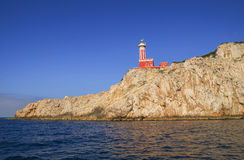 Punta Carena Lighthouse on the coastal rocks  in Capri island Royalty Free Stock Image