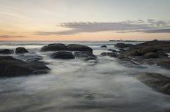 Punta del Diablo, Uruguay. Long exposure seascape with rocks at sunrise. Punta del Diablo, Uruguay, South America Royalty Free Stock Image