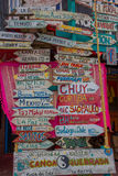 PUNTA DEL ESTE, URUGUAY - MAY 06, 2016: lot of city names annd its distance written in wood arrows Royalty Free Stock Image