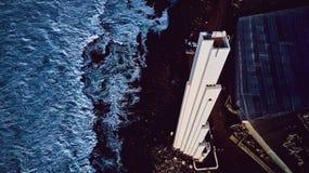 Punta del Hidalgo Lighthouse Paisaje que pasa por alto el océano Puesta del sol imagenes de archivo
