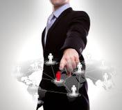 Punta del hombre de negocios a la red social Imagen de archivo libre de regalías