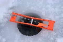 Punta di pesca del ghiaccio sul primo piano del particolare fotografia stock